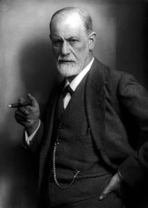 Freud with one of his beloved cigars, 1922. Max Halberstadt [Public domain], via Wikimedia Commons.